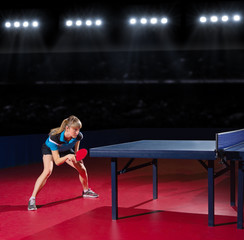 Girl table tennis player at sports hall