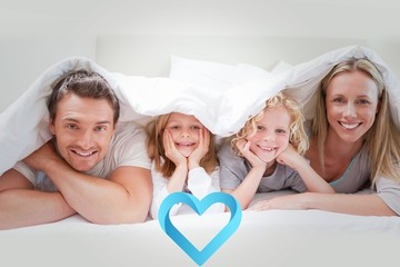 Composite image of family under the cover