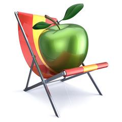 Green apple sitting in beach chair