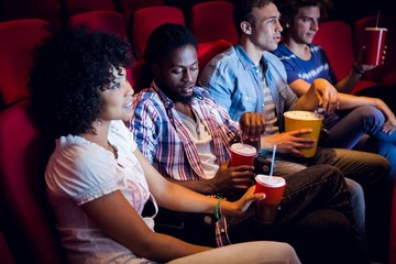Young friends watching a film
