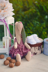 Booties on decorated table lamp nuts, toy rabbit