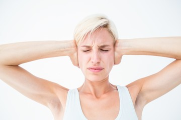 Upset woman covering her ears