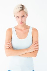 Upset blonde looking at camera with arms crossed