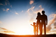 Happy family together, parents with their child at sunset. - 81356106