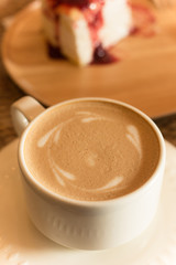 a cup of coffee with crepe cake, selective focus.