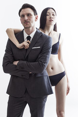Businessman and chinese model couple