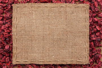 Frame made of burlap with the line lies on cranberry