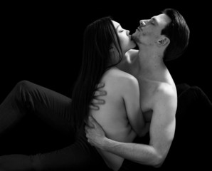 Bare-chested lovers couple black and white