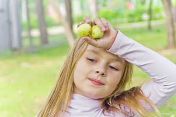Cute girl with apples