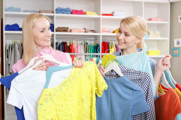 Sales woman and a customer with hangers