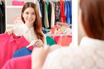 Female shopper looks at the mirror