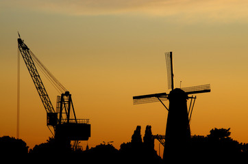 A hoisting crane and a windmill