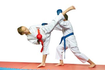 Athletes train high kicks to the head