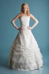 Image of smiling model touts elegant wedding dress