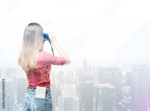Young tourist woman is taking the picture of New York city