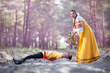 Couple on nature in russian national dress