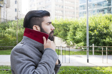 portrait of young hipsters businessman around a modern city