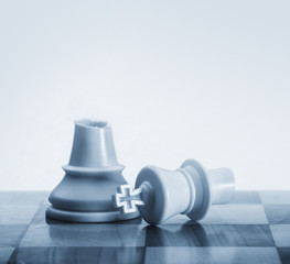 Close up metaphor of broken king on chess board