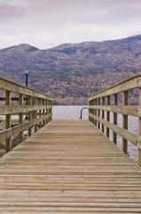 Weathered wooden walkway to dock