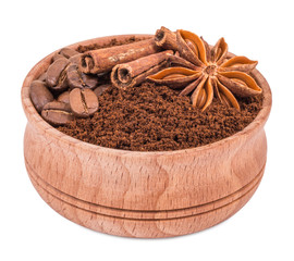 ground coffee in a wooden bowl isolated on white background
