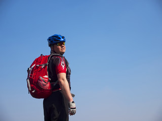 A man in a helmet and a backpack on a mountain.