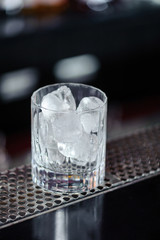 Glass with ice in a bar