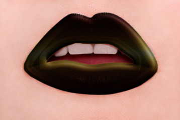 Expression rock style lip make-up like a vampire, dark romantic.
