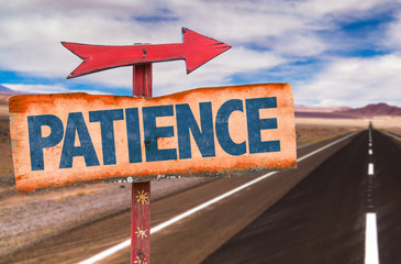 Patience sign with road background