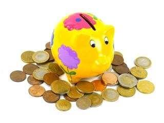 A piggy bank or a money box with euro coins over white