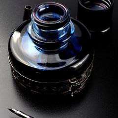 Studio shot of a blue ink bottle