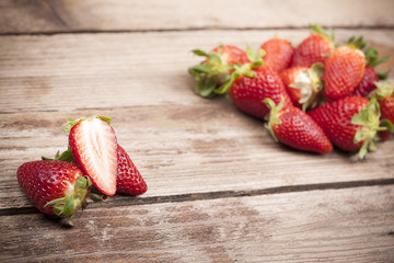 Ripe strawberries on rustic wooden background