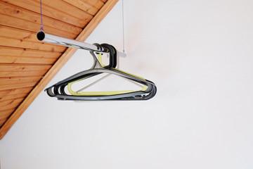 Coat hangers on clothes rail.