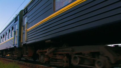 Blue passenger train in movement.