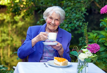 Happy Senior Woman in Coffee Time at the Garden.