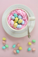 Mini Easter eggs in cup in vertical format