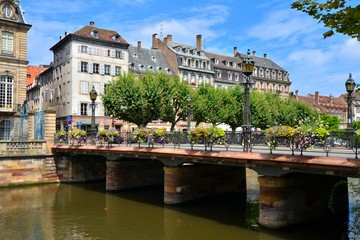 Beautiful canals of Strasbourg, France with flower line bridge