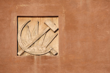 Hammer and Sickle. Stucco decoration in Yekaterinburg, Russia.