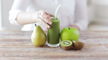 close up of woman hands with juice and fruits
