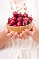 bowl of cherries in women's hands