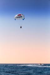 parasailing over blue sea