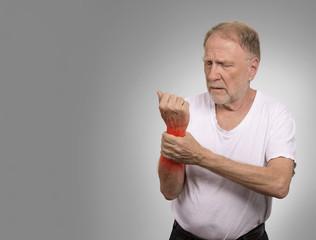 senior man in excruciating hand ache painful wrist arthritis