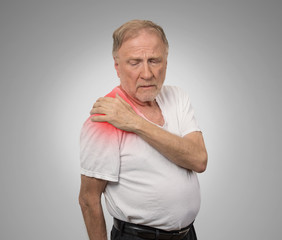senior man with pain in his shoulder.