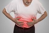 Stomach ache, man placing hands on the abdomen - 81371360