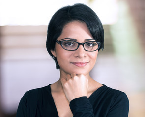 Young latin woman smiling wearing eyeglasses