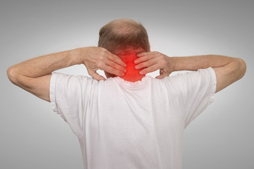 Old man with neck spasm pain touching red inflamed area