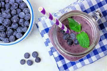 Blueberry smoothie with mint in mason jar mug, downward view