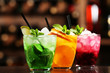 Glasses of cocktails on bar background - 81373753