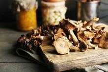 """Постер, картина, фотообои """"Dried mushrooms on cutting board, closeup"""""""