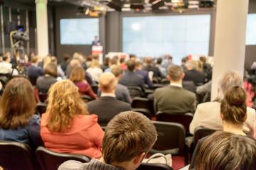 Speaker at business workshop and presentation.