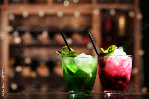 Glasses of cocktails on bar background - 81373748